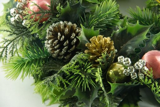 Decorated cone in green christmas garland